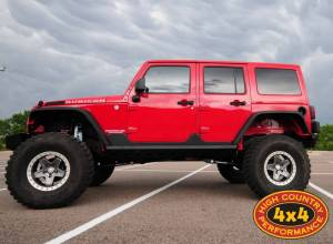 "2012 JEEP JKUR TERAFLEX 6"" SUSPENSION ON 37"" GOODYEAR MTR TIRES AND AEV BEADLOCKS WITH NEMESIS INDUSTRIES ARMOUR (BUILD#44186)"
