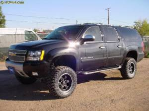 "GMC / CHEVROLET - CHEVY / GMC FULL SIZE SUV (2007-2014) - HCP 4x4 Vehicles - 7"" BDS Suspension lift and has 35x12.5R17 Toyo Open Country MT tires"